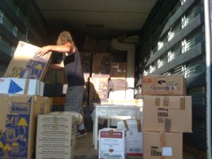 movers Auckland mover Arthur moving boxes in to our Auckland based truck.